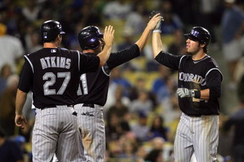 LOS ANGELES, CA - AUGUST 19:  Ian Stewart #24 of the Colorado Rockies celebrates his three-run eighth inning home run with teammates Brad Hawpe #11 and Garrett Atkins #27 during their MLB game against the Los Angeles Dodgers at Dodger Stadium on August 19