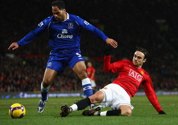 MANCHESTER, UNITED KINGDOM - JANUARY 31:  Joleon Lescott of Everton is tackled by Dimitar Berbatov of Manchester United during the Barclays Premier League match between Manchester United and Everton at Old Trafford on January 31, 2009 in Manchester, Engla