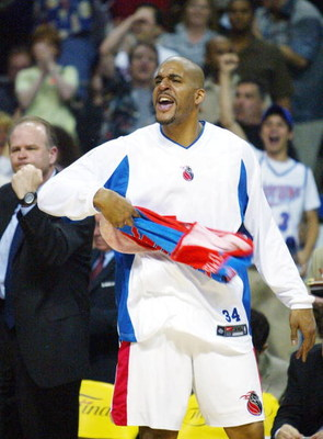 AUBURN HILLS, MI - JUNE 13:  Corliss Williamson #34 of the Detroit Pistons celebrates on the bench during the second quarter in game four of the 2004 NBA Finals against the Los Angeles Lakers on June 13, 2004 at The Palace of Auburn Hills in Auburn Hills,