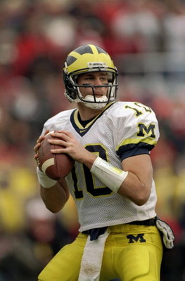 21 Nov 1998:  Quarterback Tom Brady #10 of the Michigan Wolverines in action during the game against the Ohio State Buckeyes at the Ohio Stadium in Columbus, Ohio. The Buckeyes defeated the Wolverines 31-16. Mandatory Credit: Rick Stewart  /Allsport