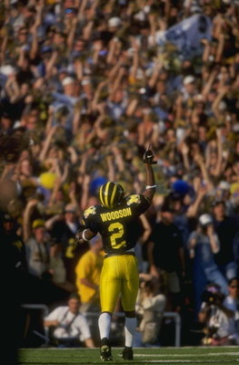 1 Jan 1998:  Charles Woodson #2 of Michigan celebrates during a game against Washington State at Rose Bowl in Pasadena, California.  Michigan defeated Washington State 21-16. Mandatory Credit: Jed Jacobsohn  /Allsport