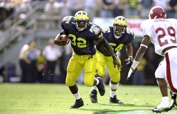 1 Jan 1999:  Anthony Thomas #32 of the Michigan Wolverines in action during the Florida Citrus Bowl Game against the Arkansas Razorbacks at the Citrus Bowl in Orlando, Florida. The Wolverines defeated the Razorbacks 45-31. Mandatory Credit: Andy Lyons  /A