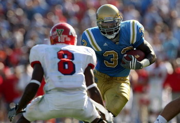 PASADENA, CA - SEPTEMBER 27:  Derrick Coleman #33 of the UCLA Bruins goes up against Sharrod Davis #8 of the Frenso State Bulldogs during the game on September 27, 2008 at the Rose Bowl in Pasadena, California.  (Photo by Stephen Dunn/Getty Images)