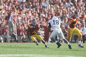 PASADENA, CA - JANUARY 1:  Joe McKnight #4 of the USC Trojans carries the ball against Navorro Bowman #18 of the Penn State Nittany Lions on January 1, 2009 at the Rose Bowl in Pasadena, California.  USC won 38-24.  (Photo by Jeff Golden/Getty Images)