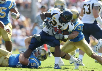 PASADENA, CA - OCTOBER 20:   James Montgomery #21 of the California Golden Bears is tackled by the UCLA Bruins defense during the game at the Pasadena Rose Bowl on October 20, 2007 in Pasadena, California.  (Photo by Lisa Blumenfeld/Getty Images)