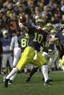 7 Nov 1998:  Quarterback Tom Brady #10 of the Michigan Wolverines throws a pass during a game against the Penn State Nittany Lions at the Michigan Stadium in Ann Arbor, Michigan. The Wolverines defeated the Nittany Lions 27-0. Mandatory Credit: Jonathan D
