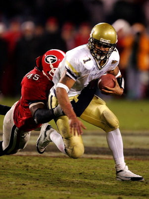 ATHENS, GA - NOVEMBER 27:  Quarterback Reggie Ball #1 of the Georgia Tech Yellow Jackets is tackled by linebacker Jarvis Jackson #45 of the Georgia Bulldogs during the game on November 27, 2004 at Sanford Stadium in Athens, Georgia.  (Photo by Scott Halle