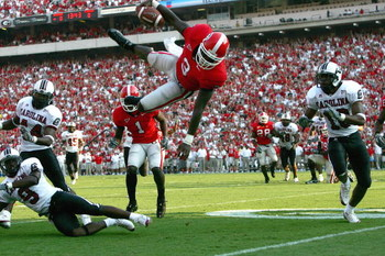 ATHENS, GA - SEPTEMBER 10:  D.J. Shockley #3 of the Georgia Bulldogs dives into the endzone for a touchdown during their game against the South Carolina Gamecocks at Sanford Stadium on September 10, 2005 in Athens, Georgia.  (Photo by Streeter Lecka/Getty