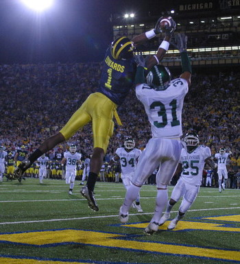 ANN ARBOR - October 30:  Wide receiver Braylon Edwards #1 of Michigan catches a touchdown pass defended by Jaren Hayes #31 of Michigan State at Michigan Stadium on October 30, 2004 in Ann Arbor, Michigan.  The Michigan Wolverines defeated the Michigan Sta