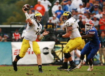 ORLANDO, FL - JANUARY 01:  Quarterback Chad Henne #7 of the Michigan Wolverines throws a pass against the Florida Gators in the Capital One Bowl at Florida Citrus Bowl on January 1, 2008 in Orlando, Florida. Michigan defeated Florida 41-35.  (Photo by Dou