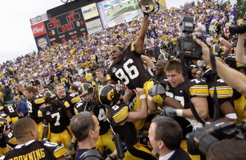 ORLANDO, FL - JANUARY 1:  Warren Holloway #86 of the Iowa Hawkeyes is carried on the field by teammates following the Capital One Bowl game against the LSU Tigers at the Florida Citrus Bowl on January 1, 2005 in Orlando, Florida. The Hawkeyes won 30-25. (