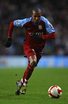 MANCHESTER, UNITED KINGDOM - MARCH 04:  Ashley Young of Aston Villa runs with the ball during the Barclays Premier League match between Manchester City and Aston Villa at the City of Manchester Stadium on March 4, 2009 in Manchester, England.  (Photo by A