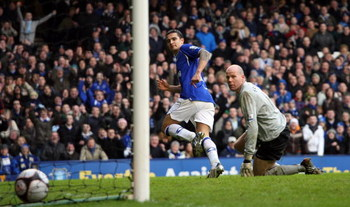 LIVERPOOL, UNITED KINGDOM - FEBRUARY 15:  Tim Cahill of Everton scores the third goal past Brad Friedel of Aston Villa during the FA Cup Sponsored by e.on 5th Round match between Everton and Aston Villa at Goodison Park on February 15, 2009 in Liverpool,