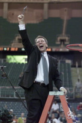 25 Mar 2001: Michigan State head coach Tom Izzo waves to fans after cutting down a net following his team's 69-62 victory over Temple during their NCAA South Region Final game at the Georgia Dome in Atlanta, Georgia.  <DIGITAL IMAGE> Mandatory Credit: And