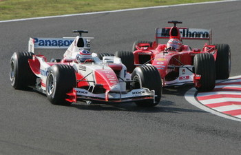 SUZUKA, JAPAN - OCTOBER 10: Rubens Barrichello of Brazil and Ferrari attempts to overtake Olivier Panis during the Japanese Grand Prix at Suzuka Circuit on October 10, 2004 in Suzuka, Japan.  (Photo by Clive Rose/Getty Images)
