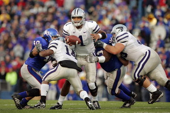 LAWRENCE, KS - NOVEMBER 18:  Quarterback Josh Freeman #1 of the Kansas State Wildcats gets caught in the rush by defensive lineman James McClinton #93 of the Kansas Jayhawks at Memorial Stadium November 18, 2006 in Lawrence, Kansas. The Kansas Jayhawks wo