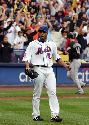 NEW YORK - SEPTEMBER 27:  Johan Santana #57 of the New York Mets celebrates the final out of the game against the Florida Marlins on September 27, 2008 at Shea Stadium in the Flushing neighborhood of the Queens borough of New York City. The Mets defeated