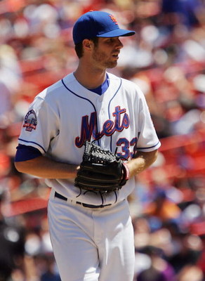 NEW YORK - JULY 10: John Maine #33 of the New York Mets pitches against the San Francisco Giants on July 10, 2008 at Shea Stadium in the Flushing neighborhood of the Queens borough of New York City. The Mets defeated the Giants 7-3. (Photo by Jim McIsaac/