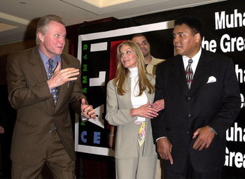 381869 05: Boxing legend Muhammad Ali, right, watches actor Jon Voight's boxing imitation as Bo Derek and Sinbad look on during 'Roast This! An Evening With Muhammad Ali and Friends' celebrity roast November 16, 2000 in Los Angeles, CA. The event benefitt