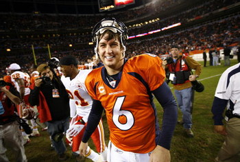 DENVER - DECEMBER 7: Quarterback Jay Cutler #6 of the Denver Broncos flashes a big smile as he shakes hands after beating the Kansas City Chiefs in week 14 NFL action at Invesco Field at Mile High on December 7, 2008 in Denver, Colorado. Denver beat Kansa