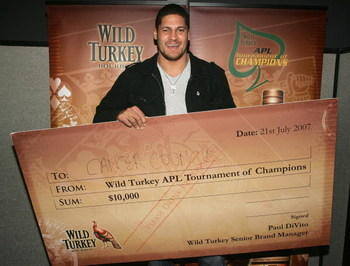SYDNEY, AUSTRALIA - JULY 21:  Rugby player Willie Mason, winner of the celebrity charity match holds his cheque during the $1M Wild Turkey APL Tournament Of Champions event at Luna Park July 21, 2007 in Sydney, Australia.  (Photo by Sergio Dionisio/Getty