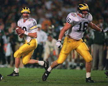 30 DEC 1994:  MICHIGAN QUARTERBACK TODD COLLINS #10 FADES BACK IN THE POCKET WITH THE BLOCKING PROTECTION OF TIGHT END JAY RIEMERSMA, #16, DURING THE FIRST QUARTER AGAINST COLORADO STATE DURING THE HOLIDAY BOWL AT JACK MURPHY STADIUM IN SAN DIEGO, CALIFOR