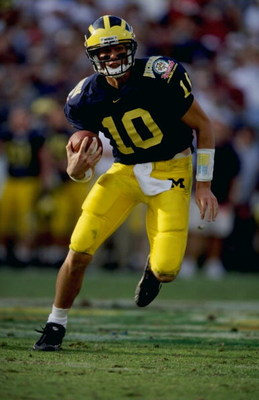 1 Jan 1999:  Tom Brady #10 of the Michigan Wolverines carries the ball during the Citrus Bowl against the Arkansas Razorbacks at the Florida Citrus Bowl in Orlando, Florida. Michigan defeated Arkansas 45-31. Mandatory Credit: Andy Lyons  /Allsport