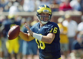 ANN ARBOR, MI - SEPTEMBER 6:  John Navarre #16 of the Michigan Wolverines looks to pass against the Houston Cougars on September 6, 2003 in Ann Arbor, Michigan. Michigan defeated Houston 50-3. (Photo by Danny Moloshok/Getty Images)