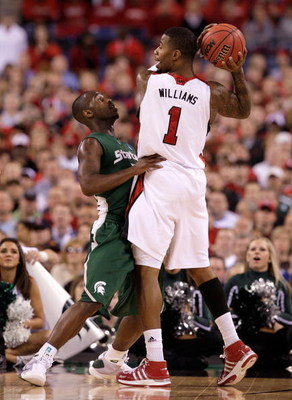 INDIANAPOLIS - MARCH 29:  Terrence Williams #1 of the Louisville Cardinals looks to pass the ball against Travis Walton #5 of the Michigan State Spartans during the fourth round of the NCAA Division I Men's Basketball Tournament at the Lucas Oil Stadium o