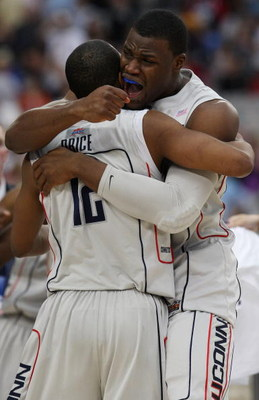GLENDALE, AZ - MARCH 28:  (R-L) Forward Jeff Adrien #4 and guard A.J. Price #12 of the Connecticut Huskies celebrate after winning the West Region by defeating the Missouri Tigers in the Elite Eight of the NCAA Division I Men's Basketball Tournament at th