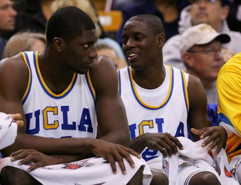 WESTWOOD, CA - FEBRUARY 02:  (L-R) Alfred Aboya #12 and Darren Collison #2 of the UCLA Bruins look on from the bench in the final minutes against the Arizona Wildcats at Pauley Pavilion on February 2, 2008 in Westwood, California.  (Photo by Lisa Blumenfe