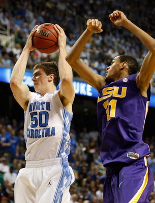 GREENSBORO, NC - MARCH 21:  Tyler Hansbrough #50 of the North Carolina Tar Heels grabs a rebound against Chris Johnson #21 of the Louisiana State University Tigers during the second round of the NCAA Division I Men's Basketball Tournament at the Greensbor