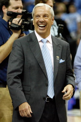 MEMPHIS, TN - MARCH 29:  Head coach Roy Williams of the North Carolina Tar Heels celebrates after defeating the Oklahoma Sooners during the NCAA Men's Basketball Tournament South Regional Final at the FedExForum on March 29, 2009 in Memphis, Tennessee. Th