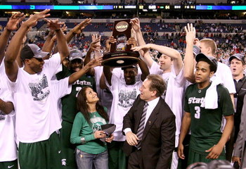 INDIANAPOLIS - MARCH 29:  Head coach Tom Izzo of the Michigan State Spartans and his wife, Lupe, celebrate with the Michigan State players after they were presented with the midwest region trophy following their 64-52 win against the Louisville Cardinals