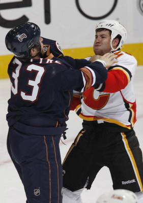 EDMONTON, CANADA - October 18: Brandon Prust #29 of the Calgary Flames and Steve MacIntyre #33 of the Edmonton Oilers get into an altercation during their NHL game on October 18, 2008 at Rexall Place in Edmonton, Alberta, Canada. (Photo by Dale MacMillan/