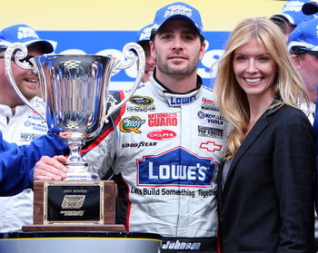 MARTINSVILLE, VA - MARCH 29:  Jimmie Johnson, driver of the #48 Lowe's Chevrolet, celebrates in victory lane with his wife, Chandra Johnson, after winning the NASCAR Sprint Cup Series Goody's Fast Pain Relief 500 at the Martinsville Speedway on March 29,