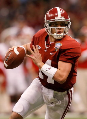NEW ORLEANS - JANUARY 02:  Quarterback John Parker Wilson #14 of the Alabama Crimson Tide rolls out of the pocket in the second quarter while taking on the Utah Utes during the 75th Allstate Sugar Bowl at the Louisiana Superdome on January 2, 2009 in New