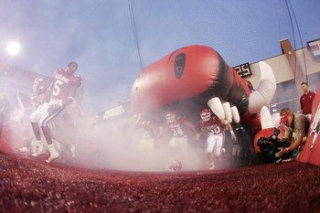 FAYETTEVILLE, AR - SEPTEMBER 2:  Players of the Arkansas Razorbacks take the field before the game against the University of Southern California Trojans on September 2, 2006 at Donald W. Reynolds Razorback Stadium in Fayetteville, Arkansas.  Southern Cali