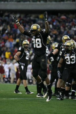 NASHVILLE, TN - DECEMBER 31:  Sean Richardson #38 of the Vanderbilt Commodores celebrates against the Boston College Eagles during the Gaylord Hotels Music City Bowl at LP Field on December 31, 2008 in Nashville, Tennessee.  (Photo by Andy Lyons/Getty Ima