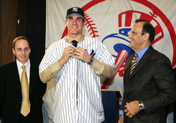 NEW YORK - DECEMBER 22:  (L to R) New York Yankees general manger Brian Cashman  with Carl Pavano and manger Joe Torre at a press conference where the Yankees announced that they have signed free-agent right-handed pitcher Carl Pavano to a four-year contr