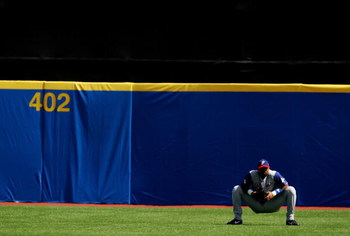 SAN JUAN, PR - MARCH 10:  Ruben Rivera #14 of Panama waits in the outfield during a pitching change against The Netherlands during their game at the World Baseball Classic at Hiram Bithorn Stadium on March 10, 2006 in San Juan, Puerto Rico.  (Photo by Al