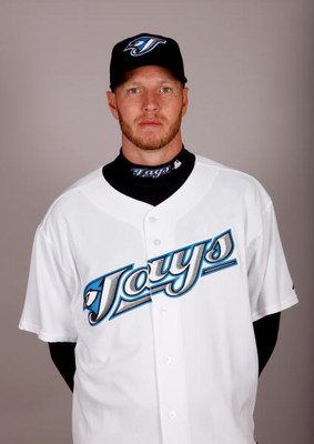 DUNEDIN, FL - FEBRUARY 23:  Roy Halladay #32 of the Toronto Blue Jays poses during photo day at the Bobby Mattick Training Center at Englebert Complex on February 23, 2009 in Dunedin, Florida.  (Photo by J. Meric/Getty Images)