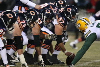CHICAGO - DECEMBER 22: Members of the Chicago Bear offensive line including Olin Kreutz #57, Roberto Garza #63 and John Tait #76 line-up in front of the Green Bay Packer defense on December 22, 2008 at Soldier Field in Chicago, Illinois. The Bears defeate