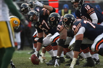 CHICAGO - DECEMBER 23: Olin Kruetz #57 of the Chicago Bears readies to make the snap against the Green Bay Packers on December 23, 2007 at Soldier Field in Chicago, Illinois. (Photo by Jonathan Daniel/Getty Images)