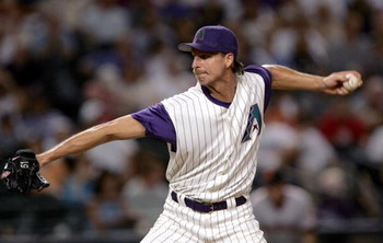 PHOENIX, AZ - SEPTEMBER 10:  Pitcher Randy Johnson #51of the Arizona Diamondbacks pitches against the San Francisco Giants on September 10, 2004 at Bank One Ballpark in Phoenix, Arizona.  (Photo by Stephen Dunn/Getty Images)