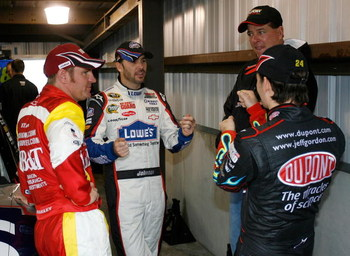 MARTINSVILLE, VA - MARCH 28: Clint Bowyer (L), driver of the #33 BB&T Chevrolet, talks with Jimmie Johnson (C), driver of the #48 Lowe's Chevrolet, Jeff Gordon (R), driver of the #24 DuPont Chevrolet, and Ron Hornaday, Jr., driver of the Camping World Tru