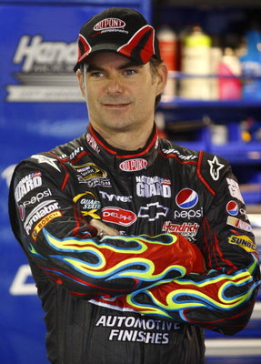 MARTINSVILLE, VA - MARCH 28: Jeff Gordon, driver of the #24 DuPont Chevrolet, stands in the garage as it rains during practice for the NASCAR Sprint Cup Series Goody's Fast Pain Relief 500 at the Martinsville Speedway on March 28, 2009 in Martinsville, Vi