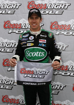 FONTANA, CA - FEBRUARY 21:  Carl Edwards, driver of the #60 Scotts Ford, poses after winning the pole position for the NASCAR Nationwide Series Stater Bros. 300 at Auto Club Speedway on February 21, 2009 in Fontana, California.  (Photo by Jason Smith/Gett