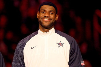 PHOENIX - FEBRUARY 15:  LeBron James,a  member of the gold medal winning USA Olympic basketball team, smiles during a special presentation during half time of the 58th NBA All-Star Game, part of 2009 NBA All-Star Weekend at US Airways Center on February 1