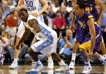 GREENSBORO, NC - MARCH 21:  Ty Lawson #5 of the North Carolina Tar Heels reaches back for a loose ball against Bo Spencer #11 of the Louisiana State University Tigers during the second round of the NCAA Division I Men's Basketball Tournament at the Greens